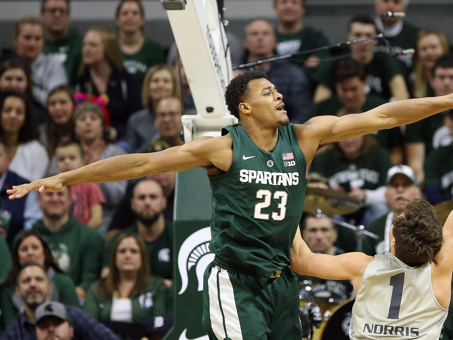 Michigan State Spartans forward Xavier Tillman (23) blocks the shot of Oakland Golden Grizzlies guard Braden Norris (1) during the second half of a game at the Breslin Center.
