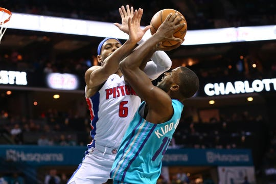Pistons guard Bruce Brown fouls Hornets forward Michael Kidd-Gilchrist on Dec. 21.