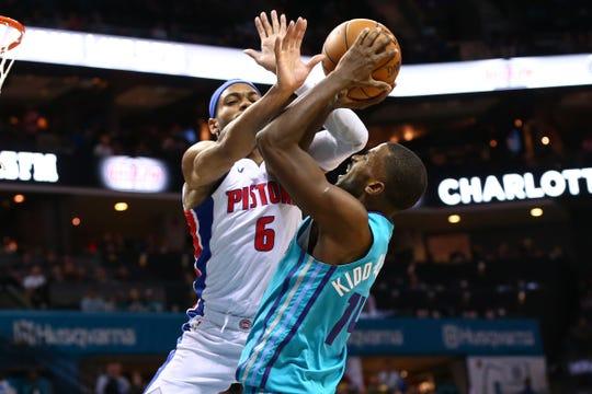 Pistons guard Bruce Brown fouls Hornets forward Michael Kidd-Gilchrist on Dec. 21.