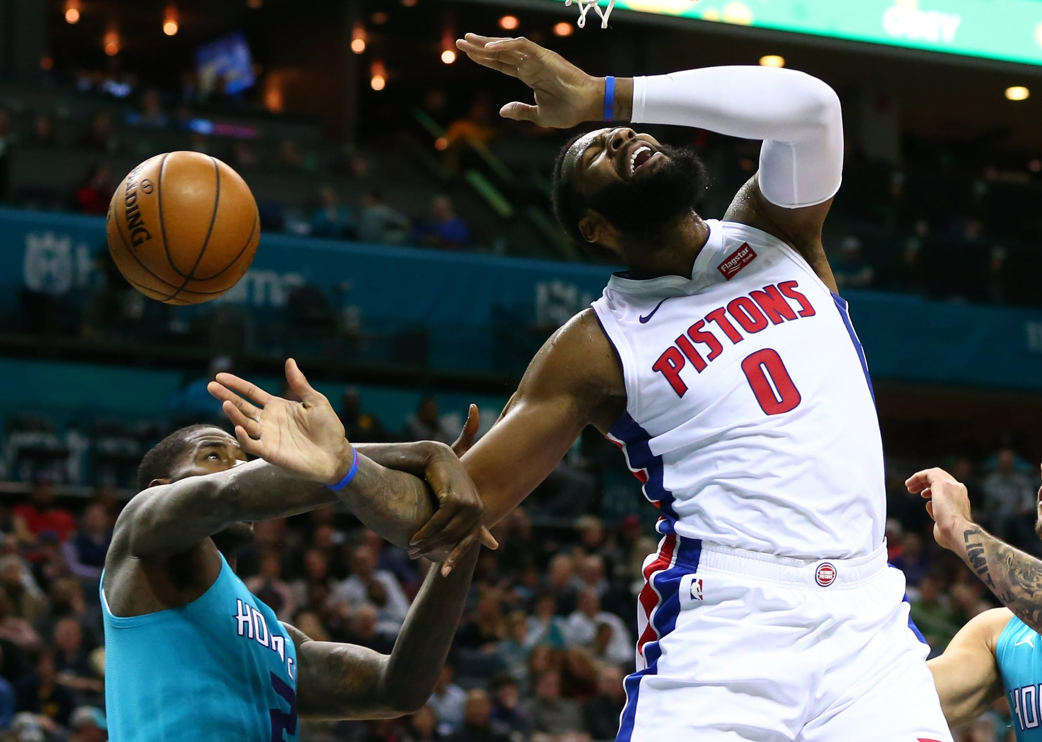 Hornets forward Marvin Williams fouls Pistons center Andre Drummond during the first half in Charlotte, N.C., on Friday, Dec. 21, 2018.