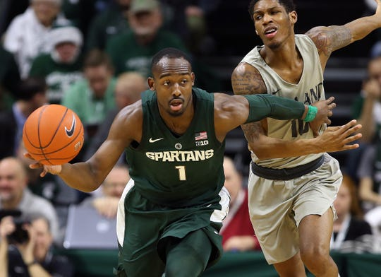 Michigan State Spartans guard Joshua Langford (1) brings the ball up court against Oakland Golden Grizzlies guard Karmari Newman (10) during the second half of a game at the Breslin Center.