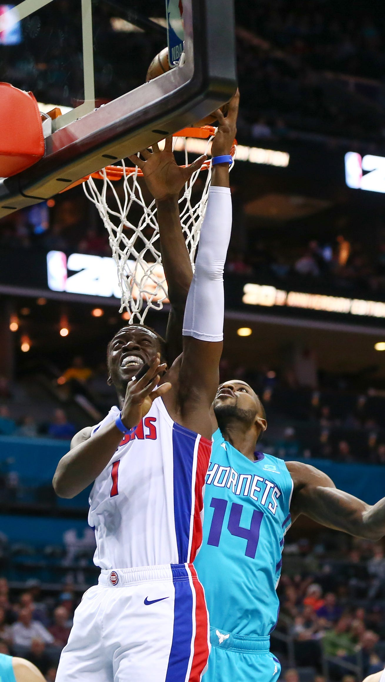 Pistons guard Reggie Jackson shoots the ball against Hornets forward Michael Kidd-Gilchrist during the first half in Charlotte, N.C., on Friday, Dec. 21, 2018.