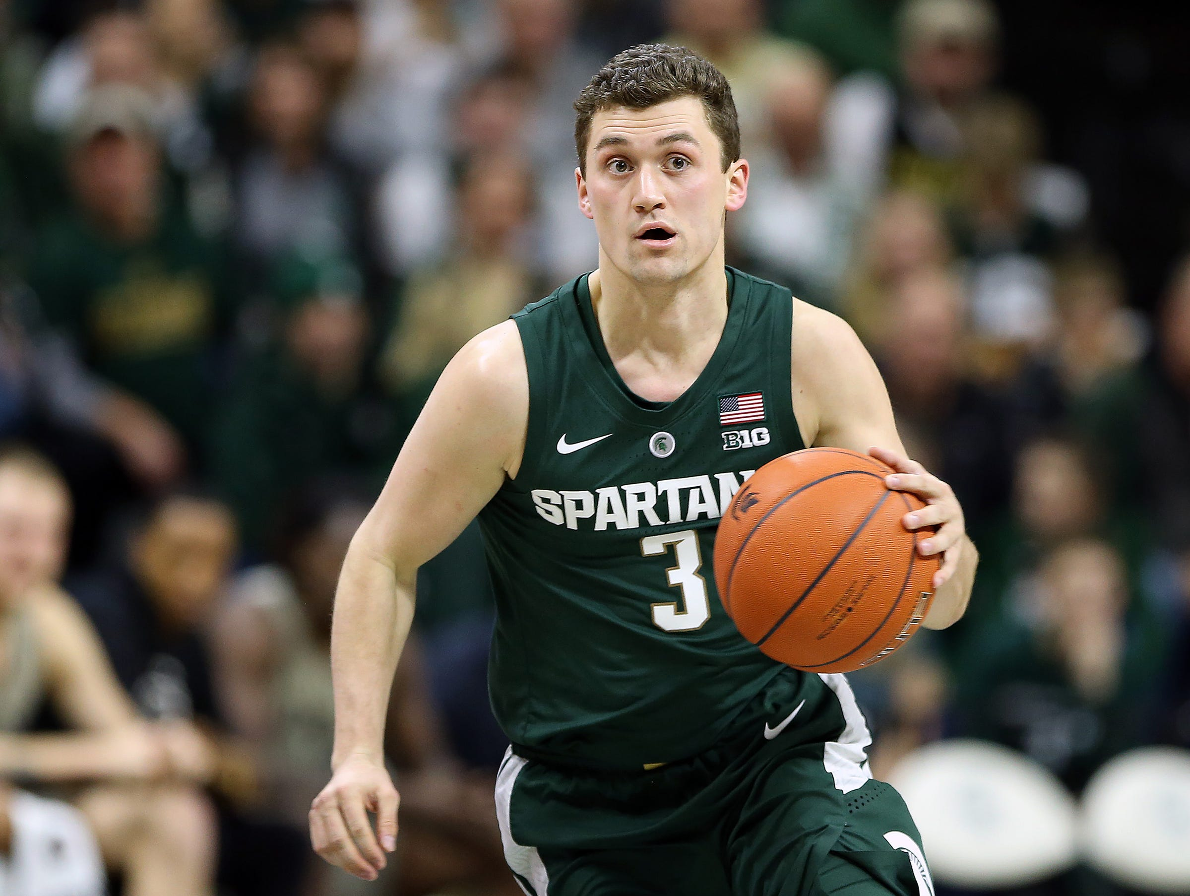 Michigan State Spartans guard Foster Loyer (3) brings the ball up court during the second half of a game against the Oakland Golden Grizzlies at the Breslin Center.