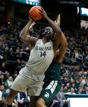 Oakland forward Xavier Hill-Mais shoots as Michigan State forward Nick Ward defends during the first half on Friday, Dec. 21, 2018, in East Lansing.