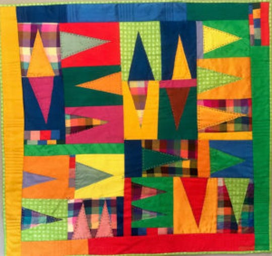 """Pennants"" is a textile work by Katie McGrath."