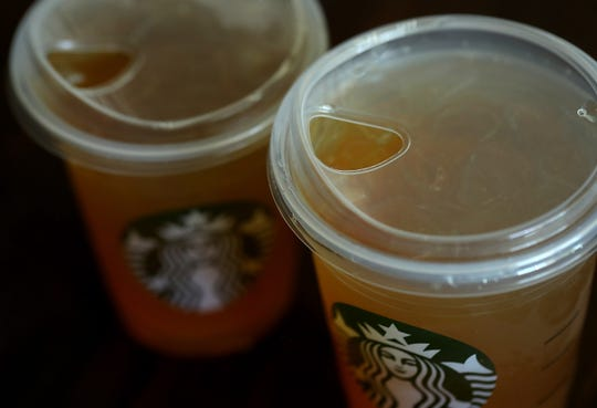 A flat plastic lid that does not need a straw is shown on a cup of Starbucks iced tea on July 9, 2018 in Sausalito, California.