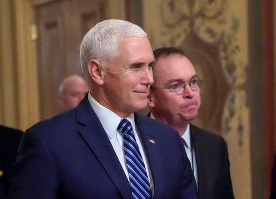 Vice President Mike Pence, left, walks with acting-White House Chief of Staff Mick Mulvaney, as they arrive at the Capitol, Saturday, Dec. 22, 2018.