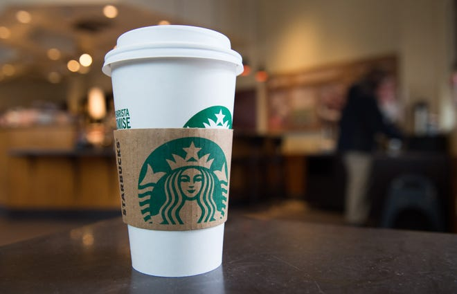 A Starbucks coffee cup.