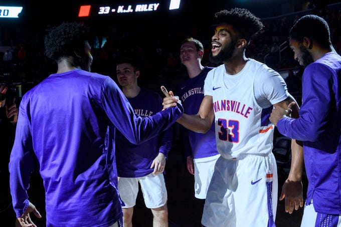 University of Evansville's K.J. Riley (33) is announced as a starter in the game against the University of Wisconsin-Green Bay Phoenix at Ford Center in Evansville, Ind., Saturday, Dec. 22, 2018.