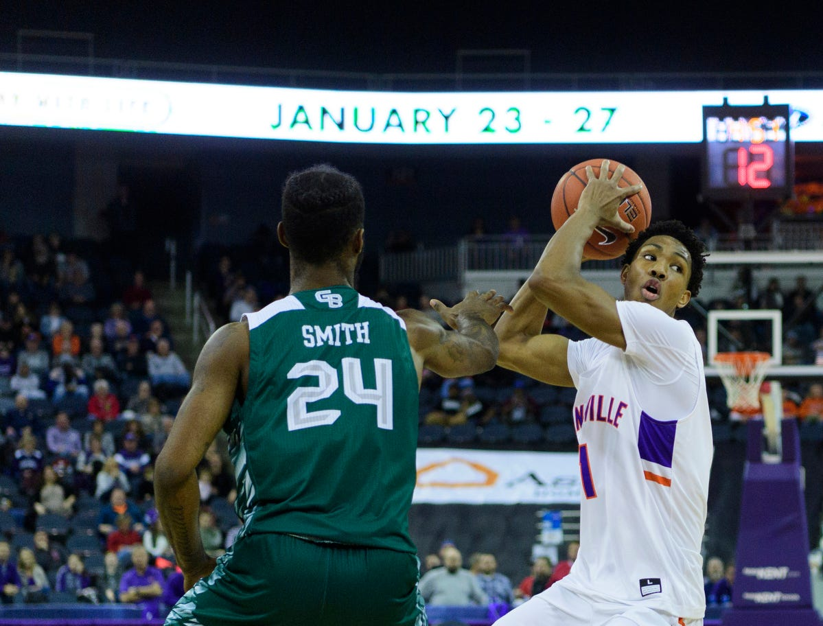 University of Evansville's Marty Hill (1) looks to make a pass while being guarded by Green Bay's Jevon Smith (24) during the first half at Ford Center in Evansville, Ind., Saturday, Dec. 22, 2018.