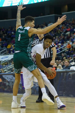 Green Bay's Sandy Cohen III (1) guards University of Evansville's Marty Hill (1) during the first half at the Ford Center in Evansville, Ind., Saturday, Dec. 22, 2018.