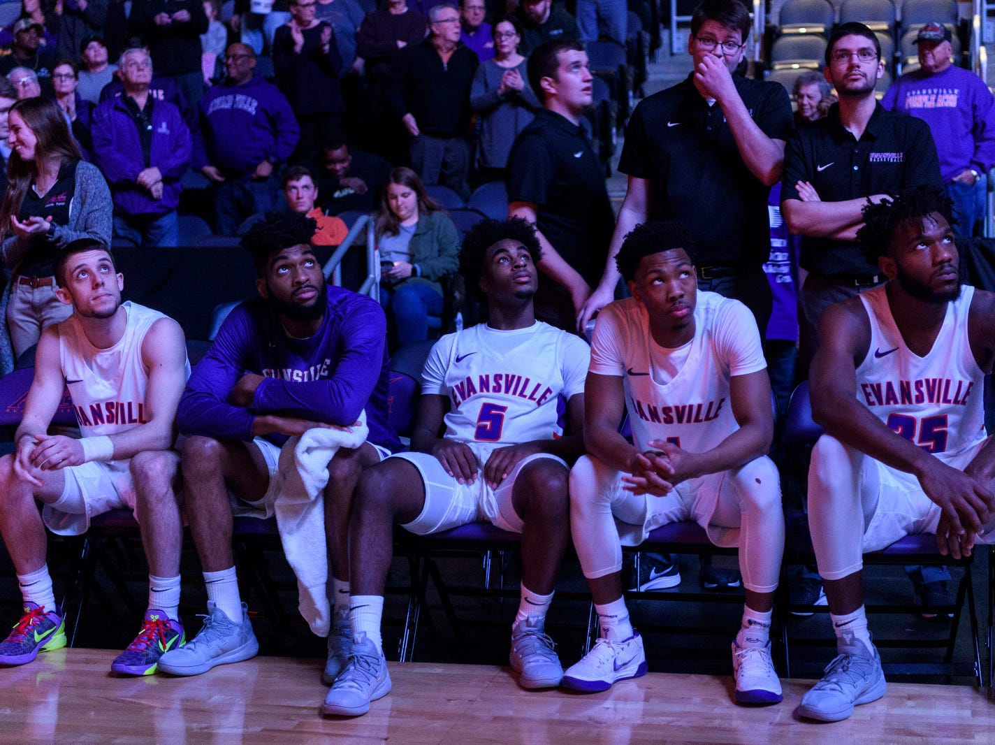 University of Evansville's Shea Feehan (21), K.J. Riley (33), Shamar Givance (5), Marty Hill (1) and  John Hall (35) wait for their names to be called during the starting line up announcement against the University of Wisconsin-Green Bay Phoenix at Ford Center in Evansville, Ind., Saturday, Dec. 22, 2018.