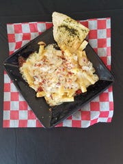 Franco's rigatoni carbonara with a creamy sauce, bacon, mushrooms and onions.