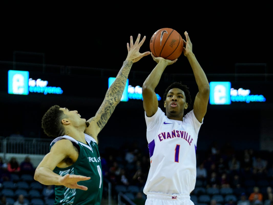 University of Evansville's Marty Hill (1) makes a jumpshot as Green Bay's Sandy Cohen III (1) attempts to block him at Ford Center in Evansville, Ind., Saturday, Dec. 22, 2018.