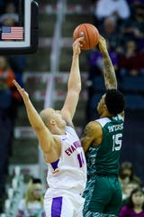 University of Evansville's Dainius Charkevicius (14) blocks Green Bay's Manny Patterson (15) during the first half at Ford Center in Evansville, Ind., Saturday, Dec. 22, 2018.