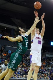 University of Evansville's Evan Kuhlman (10) takes a shot over Green Bay's Cody Schwartz (33) during the first half at Ford Center in Evansville, Ind., Saturday, Dec. 22, 2018.