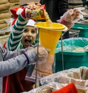 Hannah Satloff, 9 of Fort Myers, was having fun building meals. The annual Holidays Without Hunger returns this season with volunteers coming together at Lee Civic Center to pack up to 1 million or more meals for those in need. The event is hosted by Meals of Hope and is the second of two events. The other one happened Dec. 15 in Naples.