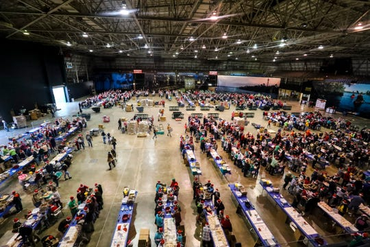 The annual Holidays Without Hunger returns this season with volunteers coming together at Lee Civic Center to pack up to 1 million or more meals for those in need. The event is hosted by Meals of Hope and is the second of two events. The other one happened Dec. 15 in Naples.
