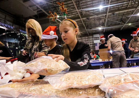 Grace Ford, 7 of Alva, organizes the finished meals. She was there volunteering her time with the Southern Pride 4-H club. The annual Holidays Without Hunger returns this season with volunteers coming together at Lee Civic Center to pack up to 1 million or more meals for those in need. The event is hosted by Meals of Hope and is the second of two events. The other one happened Dec. 15 in Naples.