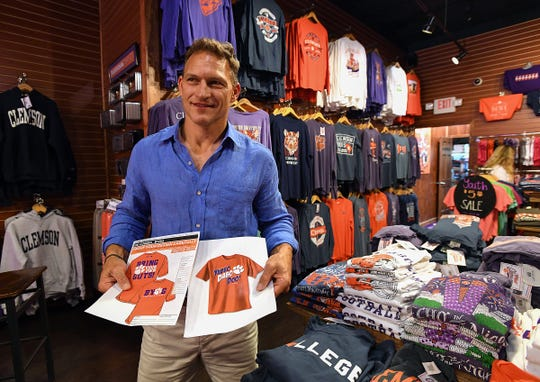 Tigertown Graphics co-owner Chris Bandy holds the artwork for a shirt printed with the phrase B.Y.O.G. in the t-shirt shop in Clemson Thursday, August 30, 2018. The shirt was printed when Clemson head coach Dabo Swinney said the phrase after the Tigers win over Notre Dame in 2015.