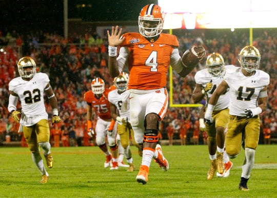Clemson quarterback Deshaun Watson (4) rushes for a touchdown during the 3rd quarter against Notre Dame in Clemson on Saturday.