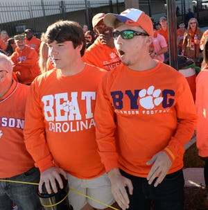 A Clemson fan wears a BYOG t-shirt printed at Tigertown Graphics as the Tigers arrive at Carolina's Williams Brice Stadium before their game against the Gamecocks Saturday, November 28, 2015 at .