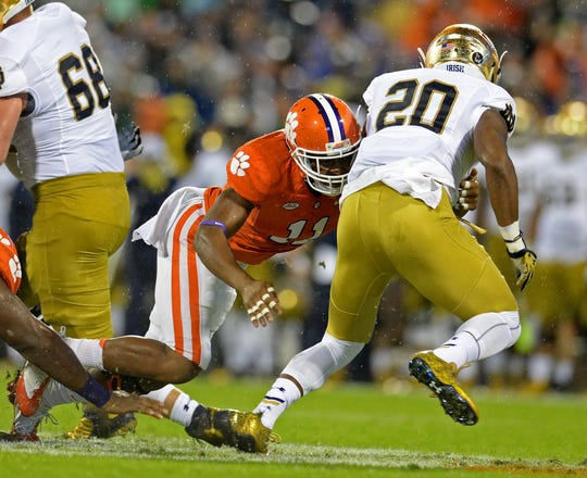 Clemson defensive back Travis Blanks (11) brings down Notre Dame running back C.J. Prosise (20) during the 1st quarter Saturday, October 3, 2015 at Clemson's Memorial Stadium.