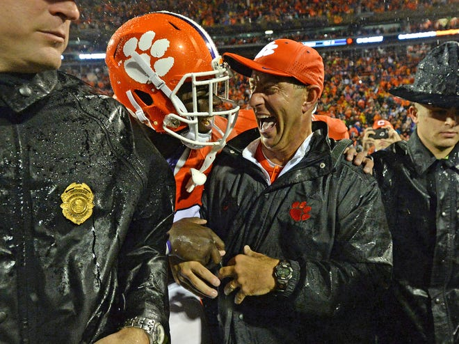 Clemson head coach Dabo Swinney celebrates with defensive tackle Kevin Dodd (98) after the Tigers 24-22 win over Notre Dame Saturday, October 3, 2015 at Clemson's Memorial Stadium.