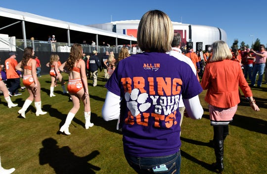 A Clemson fan wears a Tigertown Graphics t-shirt at The University of Pheonix Stadium before the National Championship game on Sunday, January 11, 2016 in Glendale, AZ.