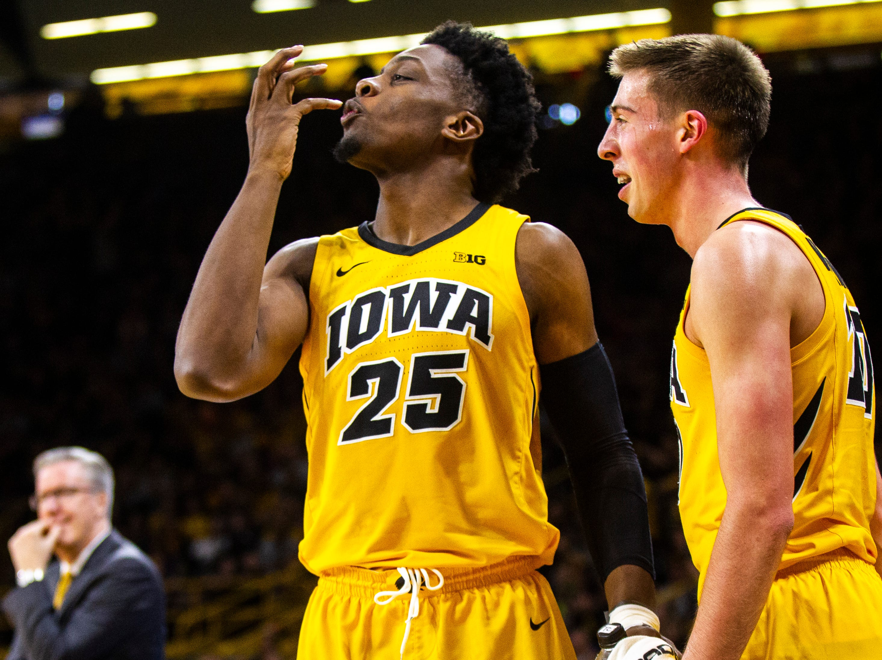 Iowa forward Tyler Cook (25) celebrates on the bench with Iowa guard Joe Wieskamp (10) during a NCAA men's basketball game on Saturday, Dec. 22, 2018, at Carver-Hawkeye Arena in Iowa City.