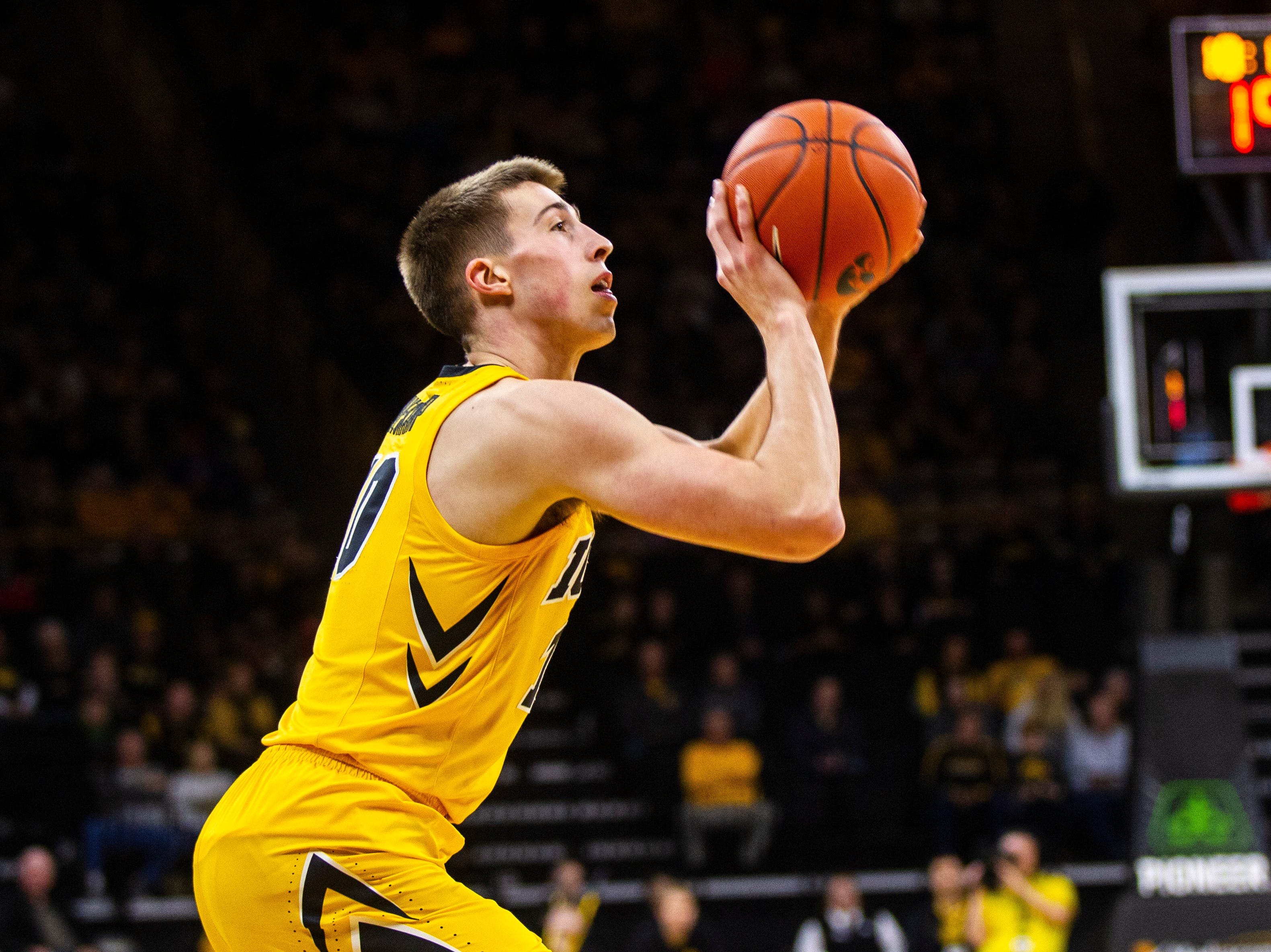 Iowa guard Joe Wieskamp (10) attempts a 3-point basket during a NCAA men's basketball game on Saturday, Dec. 22, 2018, at Carver-Hawkeye Arena in Iowa City.