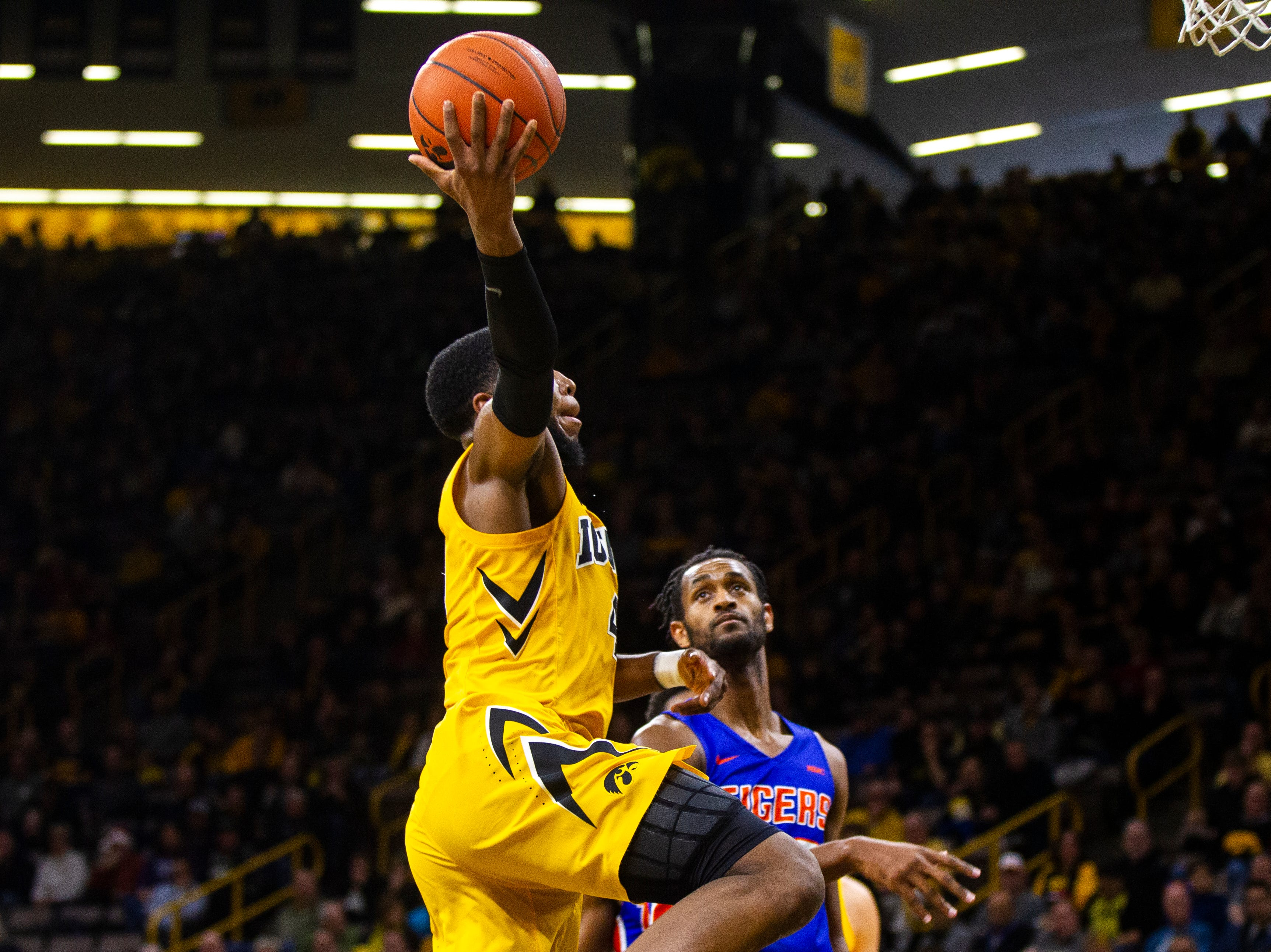 Iowa guard Isaiah Moss (4) drives to the hoop for a dunk during a NCAA men's basketball game on Saturday, Dec. 22, 2018, at Carver-Hawkeye Arena in Iowa City.