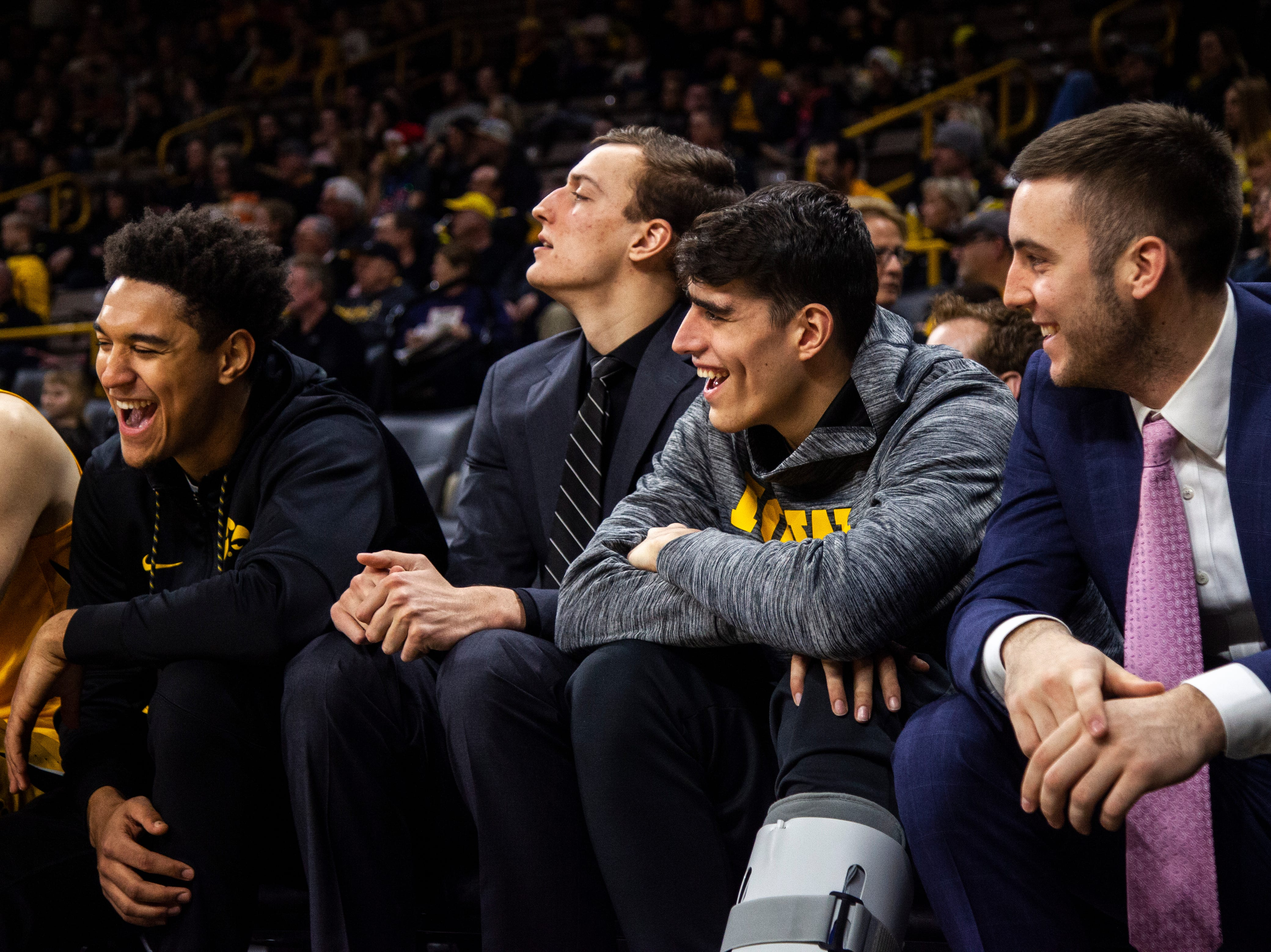 Iowa's Cordell Pemsl, Jack Nunge, Luka Garza and Connor McCaffery laugh on the bench during a NCAA men's basketball game on Saturday, Dec. 22, 2018, at Carver-Hawkeye Arena in Iowa City.