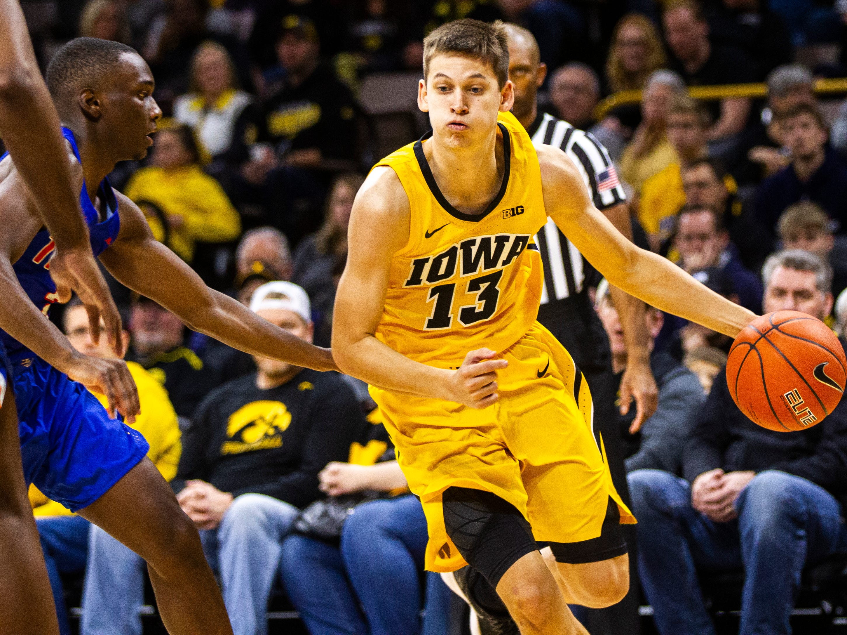 Iowa guard Austin Ash (13) drives to the hoop during a NCAA men's basketball game on Saturday, Dec. 22, 2018, at Carver-Hawkeye Arena in Iowa City.
