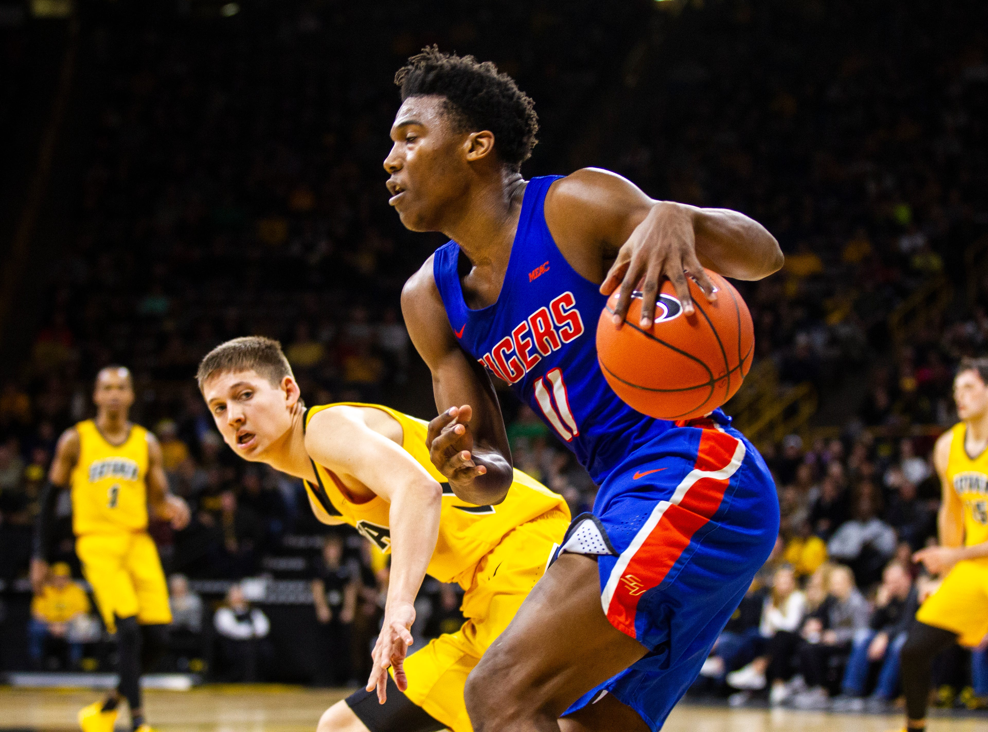 Savannah State guard Jaquan Dotson (11) grabs a rebound during a NCAA men's basketball game on Saturday, Dec. 22, 2018, at Carver-Hawkeye Arena in Iowa City.