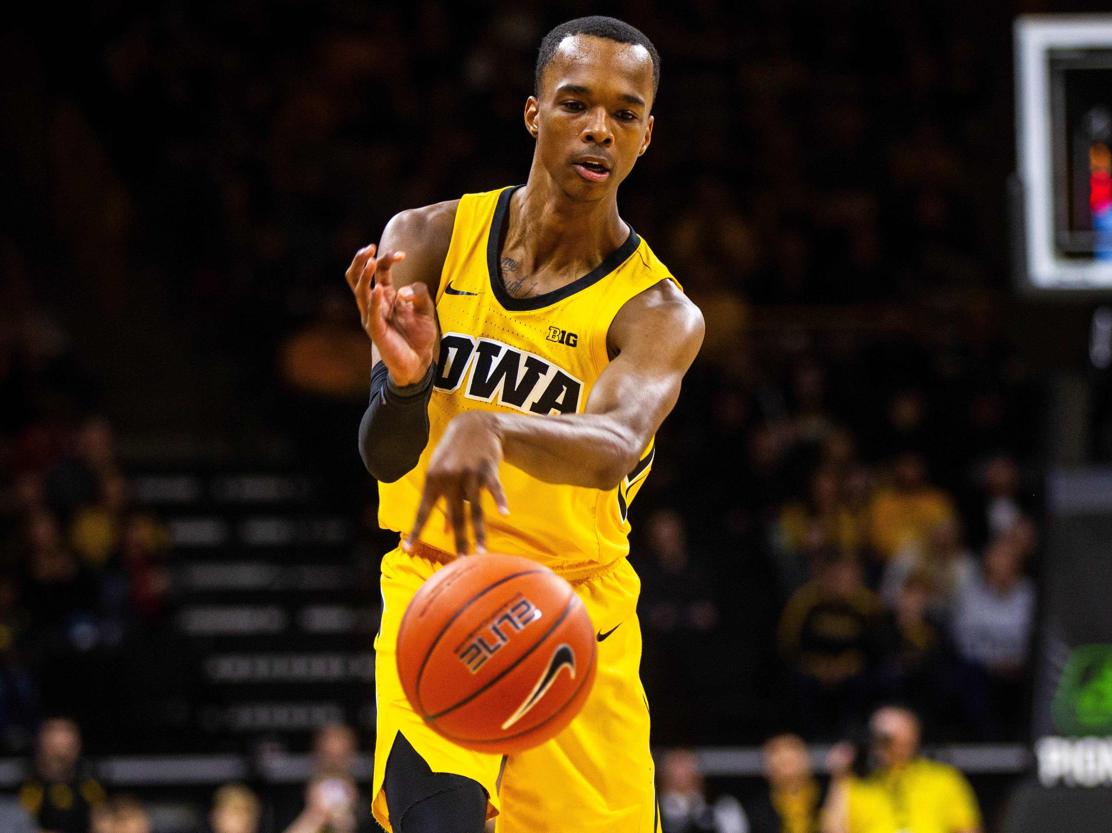 Iowa guard Maishe Dailey (1) passes to a teammate during a NCAA men's basketball game on Saturday, Dec. 22, 2018, at Carver-Hawkeye Arena in Iowa City.