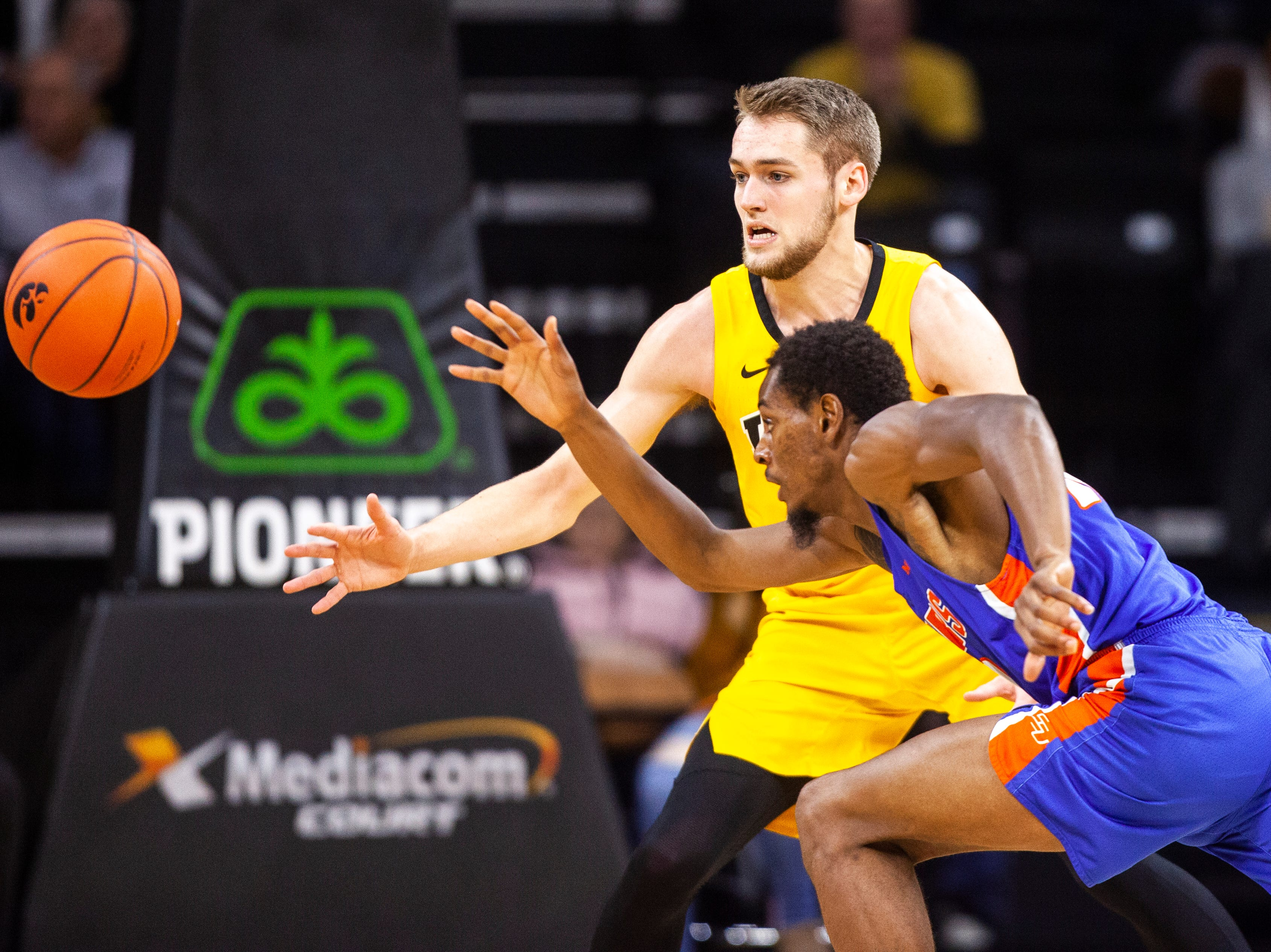 Iowa forward Riley Till (20) chases down a ball away from Savannah State forward Tyrell Harper (00) during a NCAA men's basketball game on Saturday, Dec. 22, 2018, at Carver-Hawkeye Arena in Iowa City.