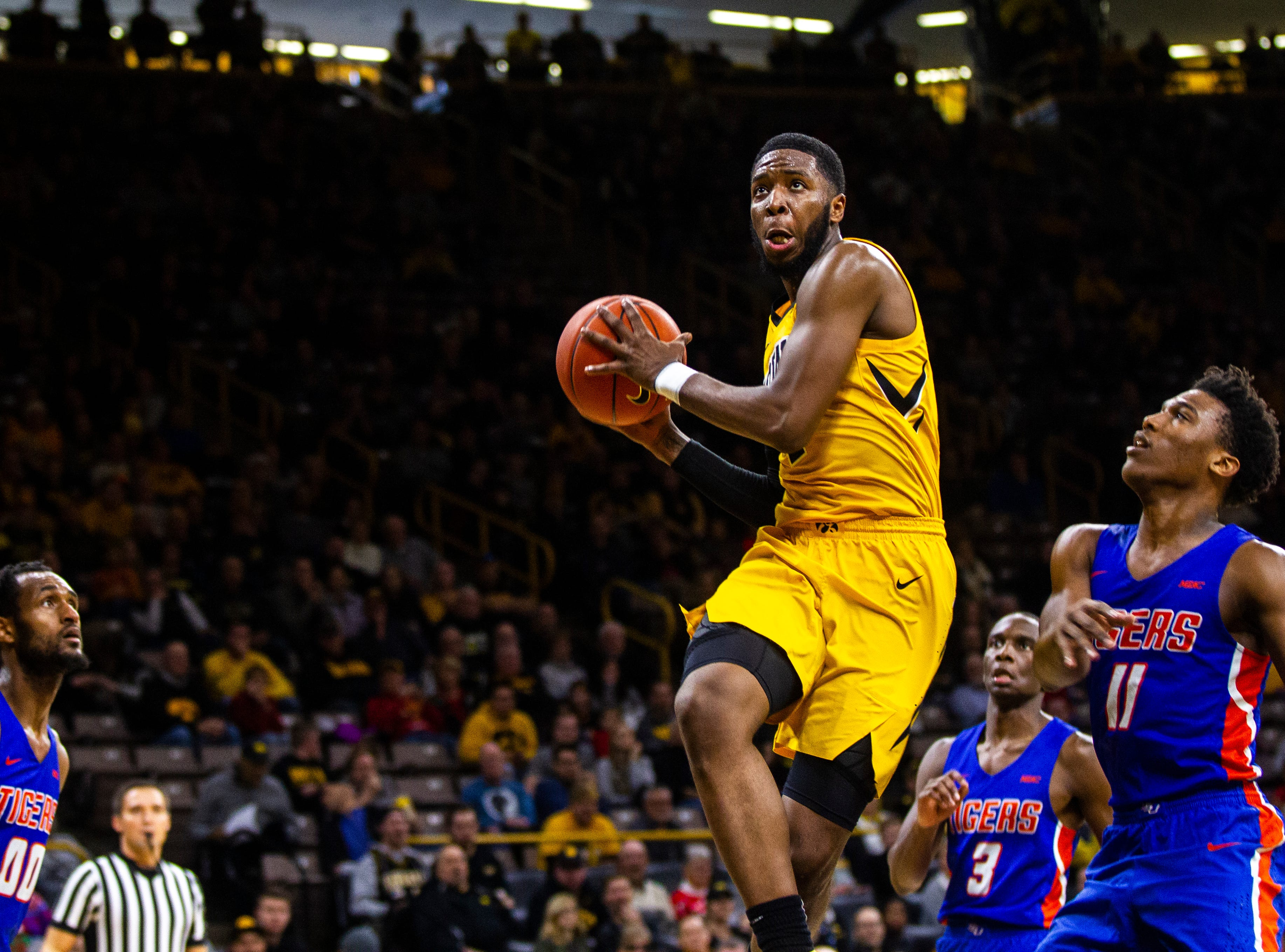 Iowa guard Isaiah Moss (4) drives to the hoop during a NCAA men's basketball game on Saturday, Dec. 22, 2018, at Carver-Hawkeye Arena in Iowa City.