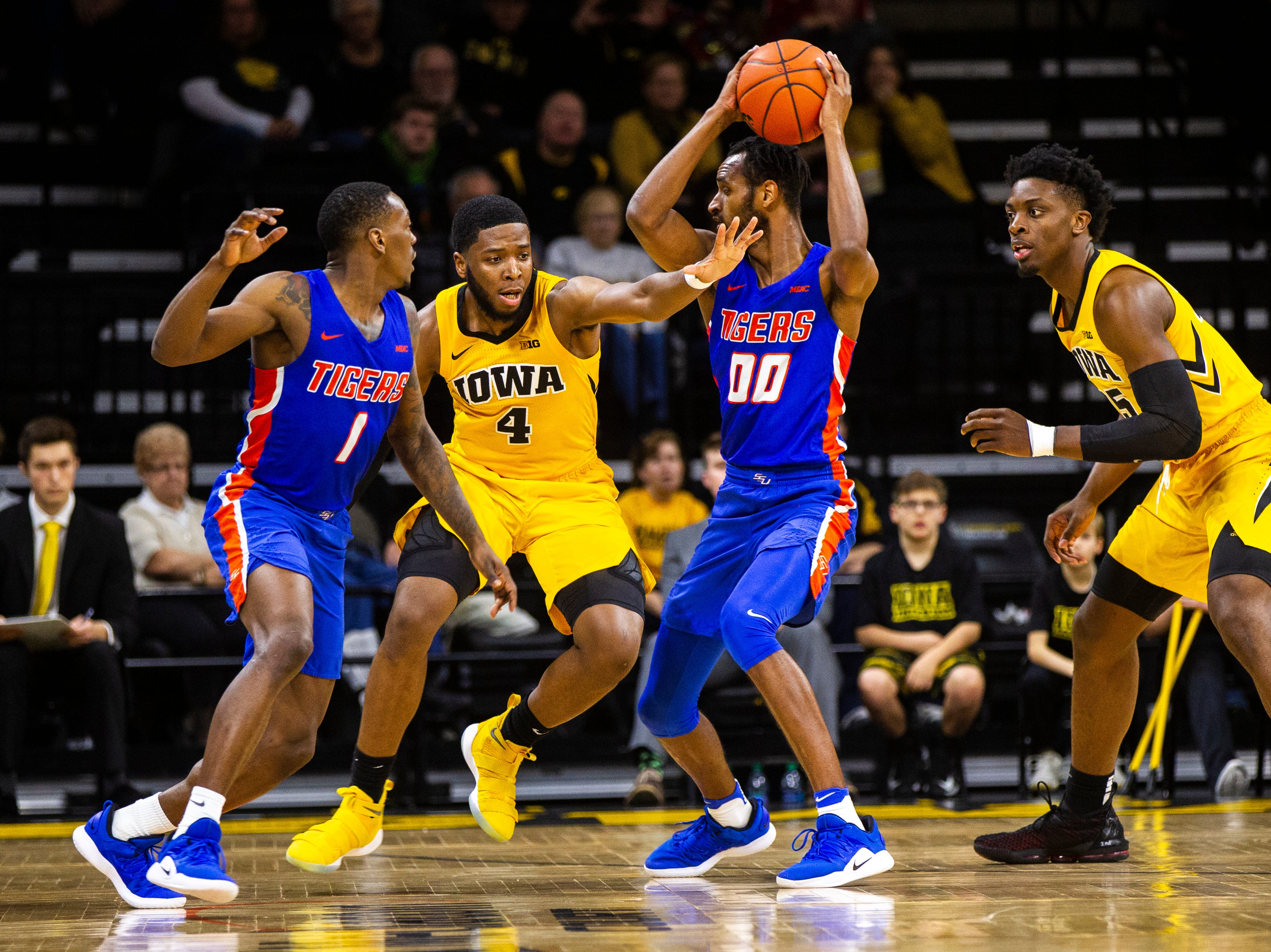 Iowa guard Isaiah Moss (4) defends Savannah State forward Tyrell Harper (00) during a NCAA men's basketball game on Saturday, Dec. 22, 2018, at Carver-Hawkeye Arena in Iowa City.