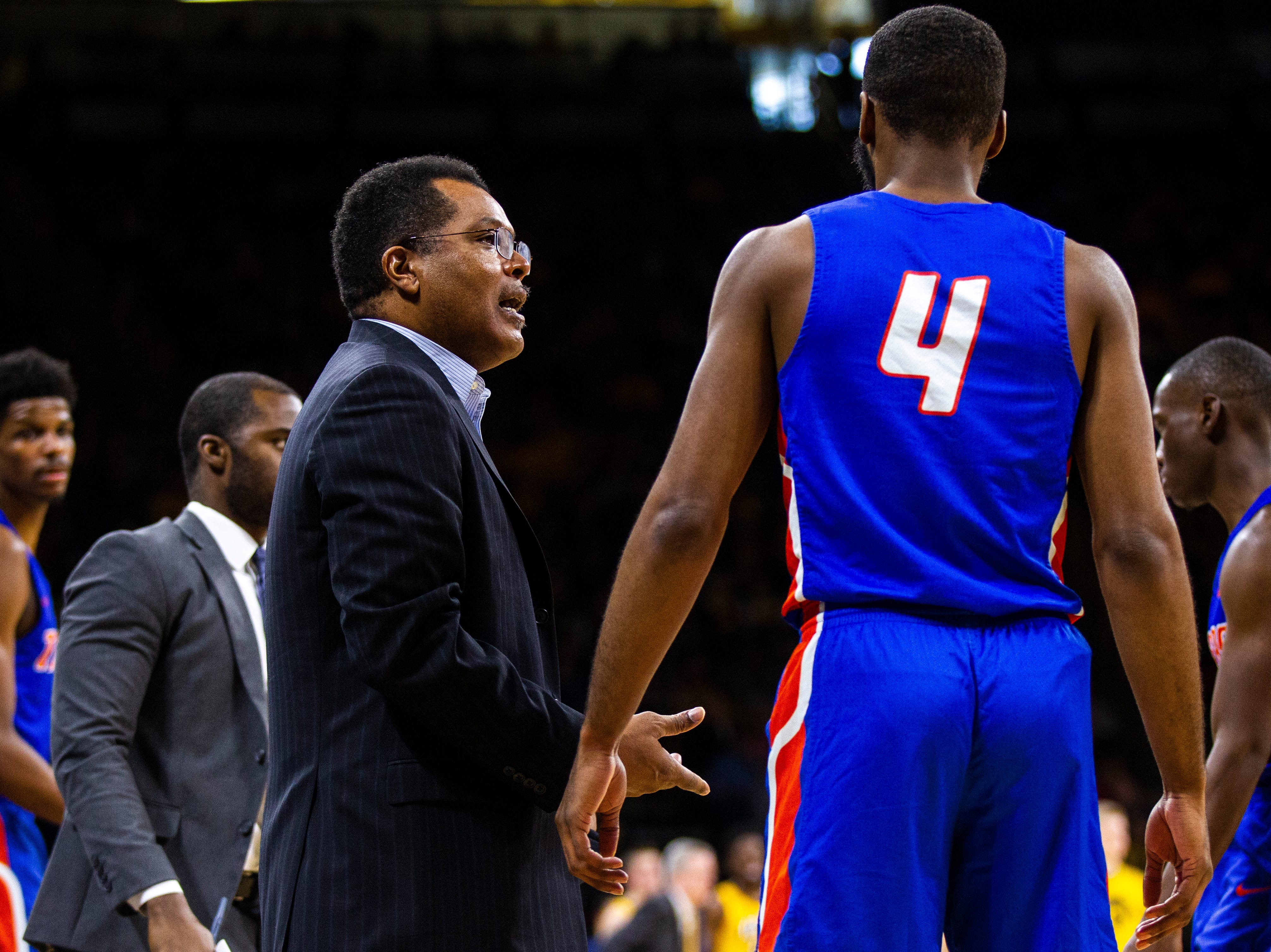 Savannah State head coach Horace Broadnax talks with Savannah State forward John Grant (4) during a NCAA men's basketball game on Saturday, Dec. 22, 2018, at Carver-Hawkeye Arena in Iowa City.