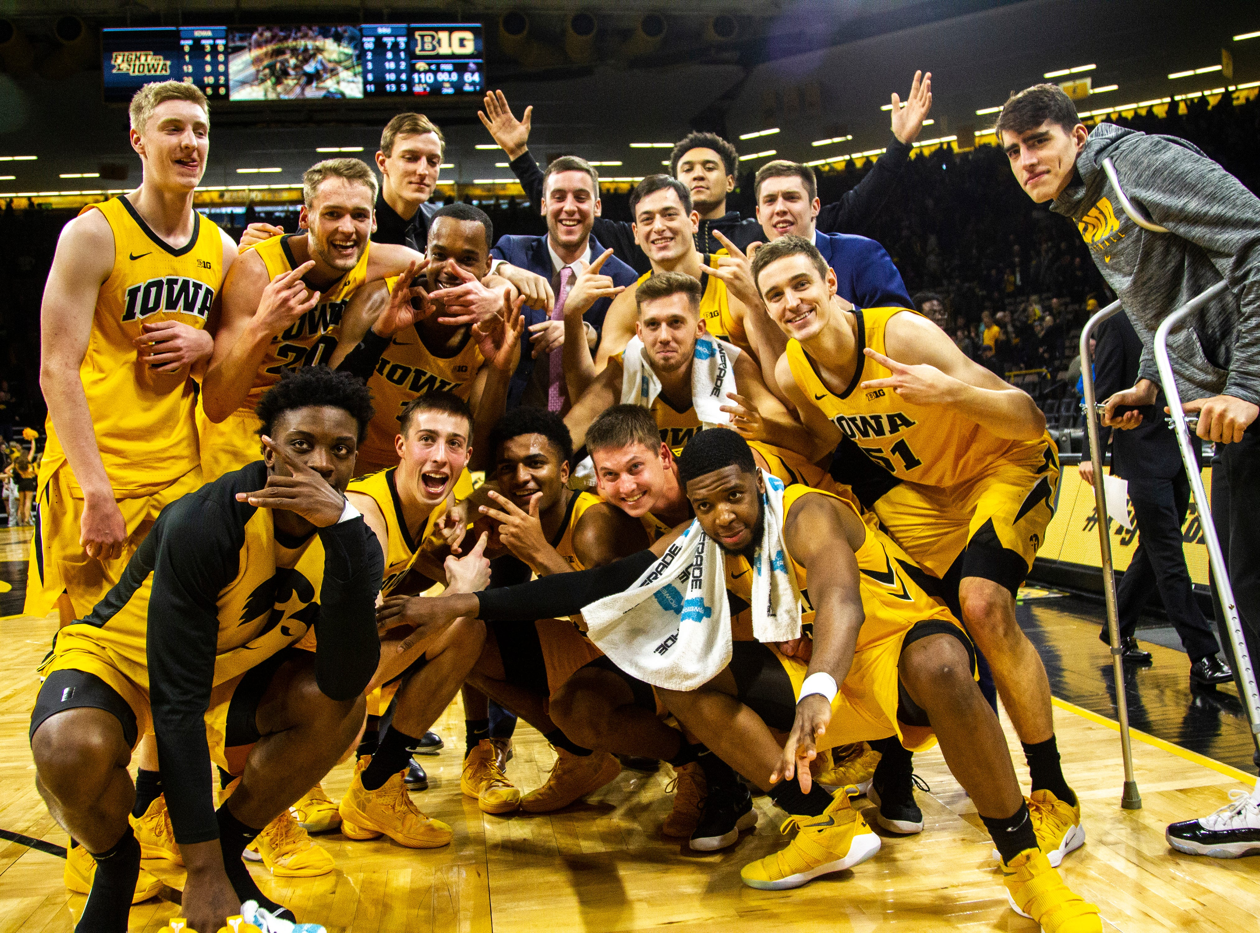 Iowa Hawkeyes players pose for a photo after a NCAA men's basketball game on Saturday, Dec. 22, 2018, at Carver-Hawkeye Arena in Iowa City. The Hawkeyes defeated Savannah State, 110-64.