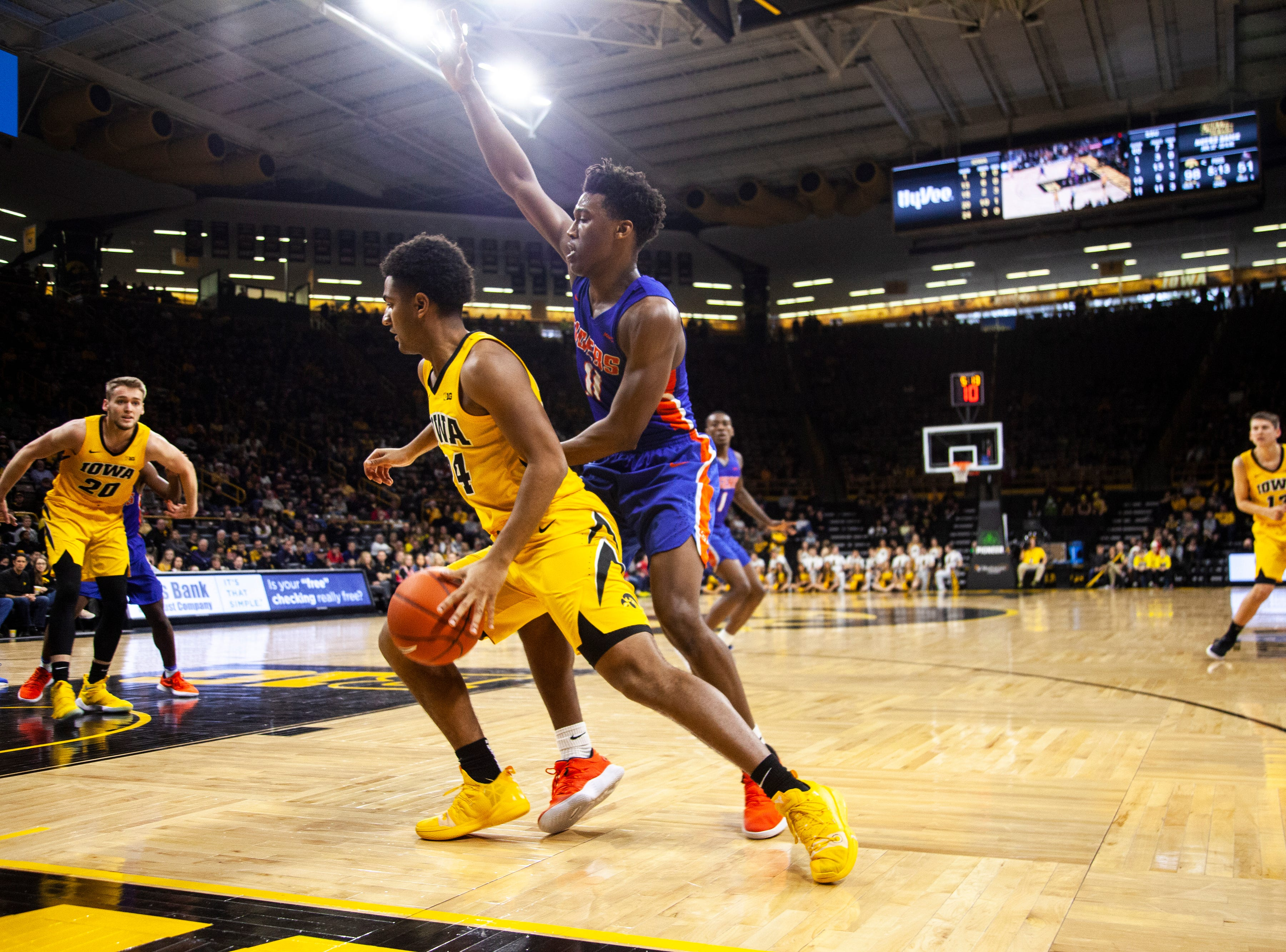 Iowa guard Nicolas Hobbs (24) gets defended by Savannah State guard Jaquan Dotson (11) during a NCAA men's basketball game on Saturday, Dec. 22, 2018, at Carver-Hawkeye Arena in Iowa City.