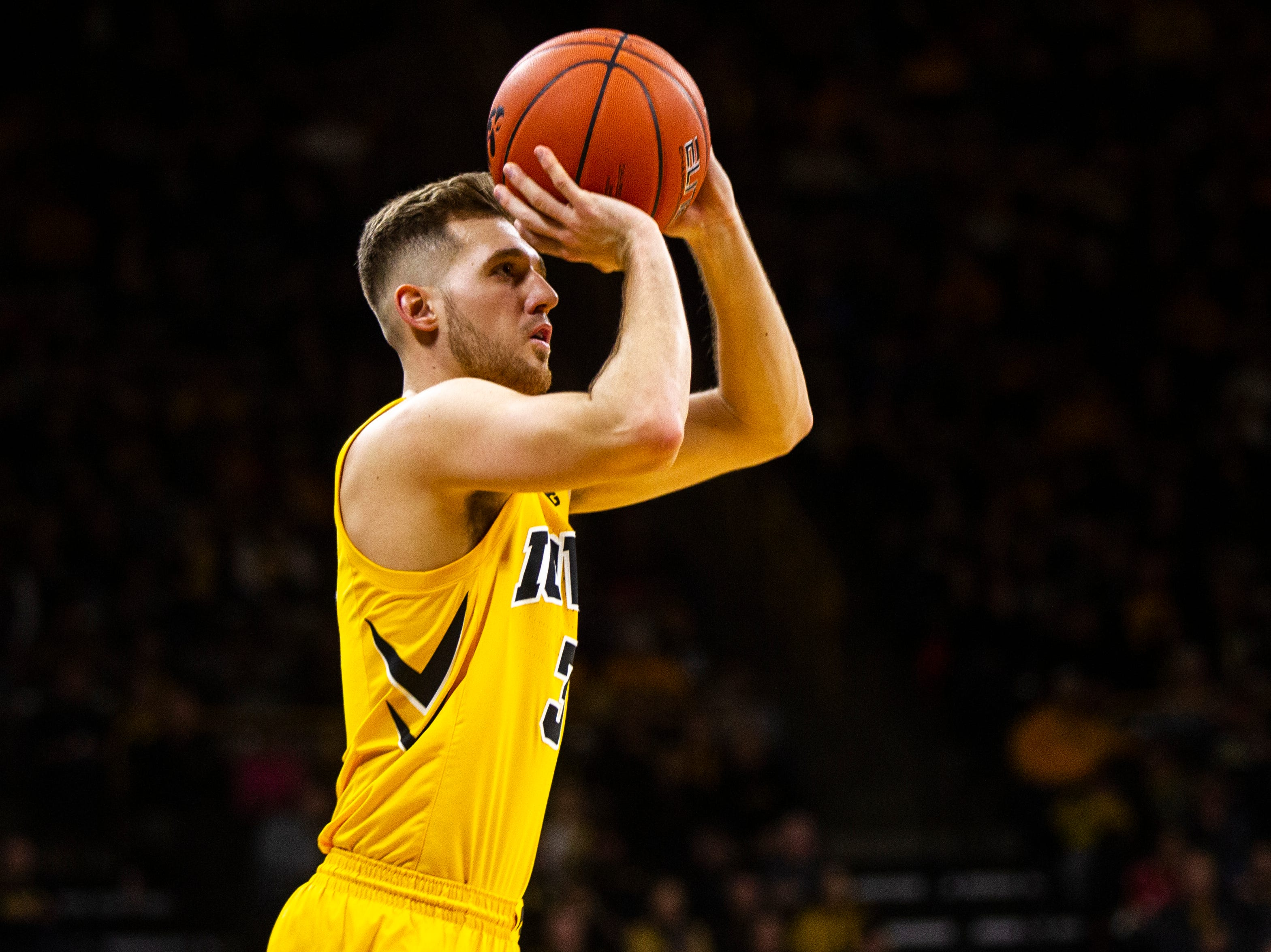 Iowa guard Jordan Bohannon (3) attempts a 3-point basket during a NCAA men's basketball game on Saturday, Dec. 22, 2018, at Carver-Hawkeye Arena in Iowa City.
