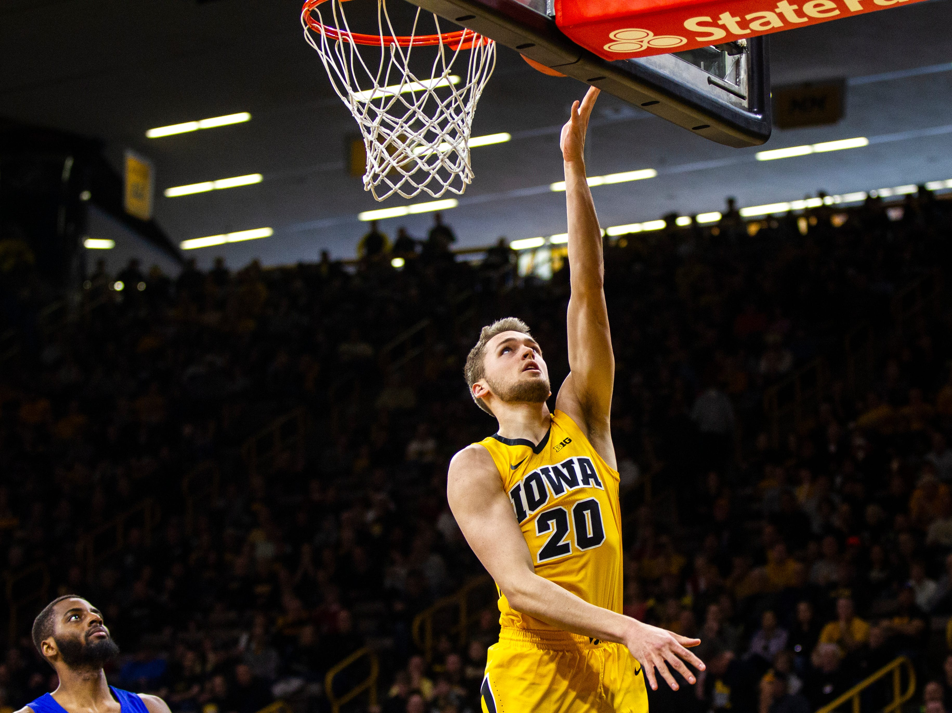 Iowa forward Riley Till (20) makes a layup during a NCAA men's basketball game on Saturday, Dec. 22, 2018, at Carver-Hawkeye Arena in Iowa City.