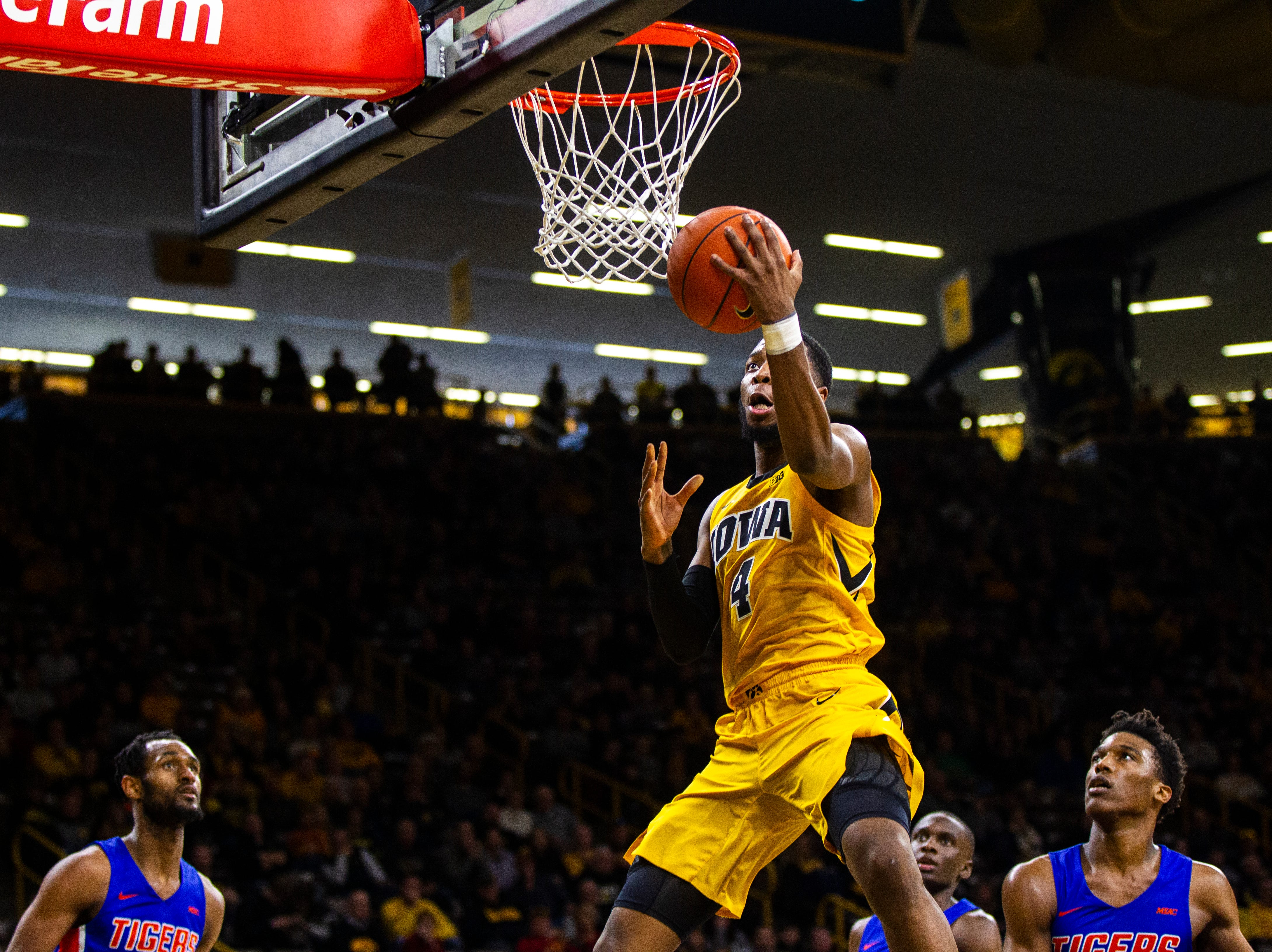 Iowa guard Isaiah Moss (4) makes a layup during a NCAA men's basketball game on Saturday, Dec. 22, 2018, at Carver-Hawkeye Arena in Iowa City.