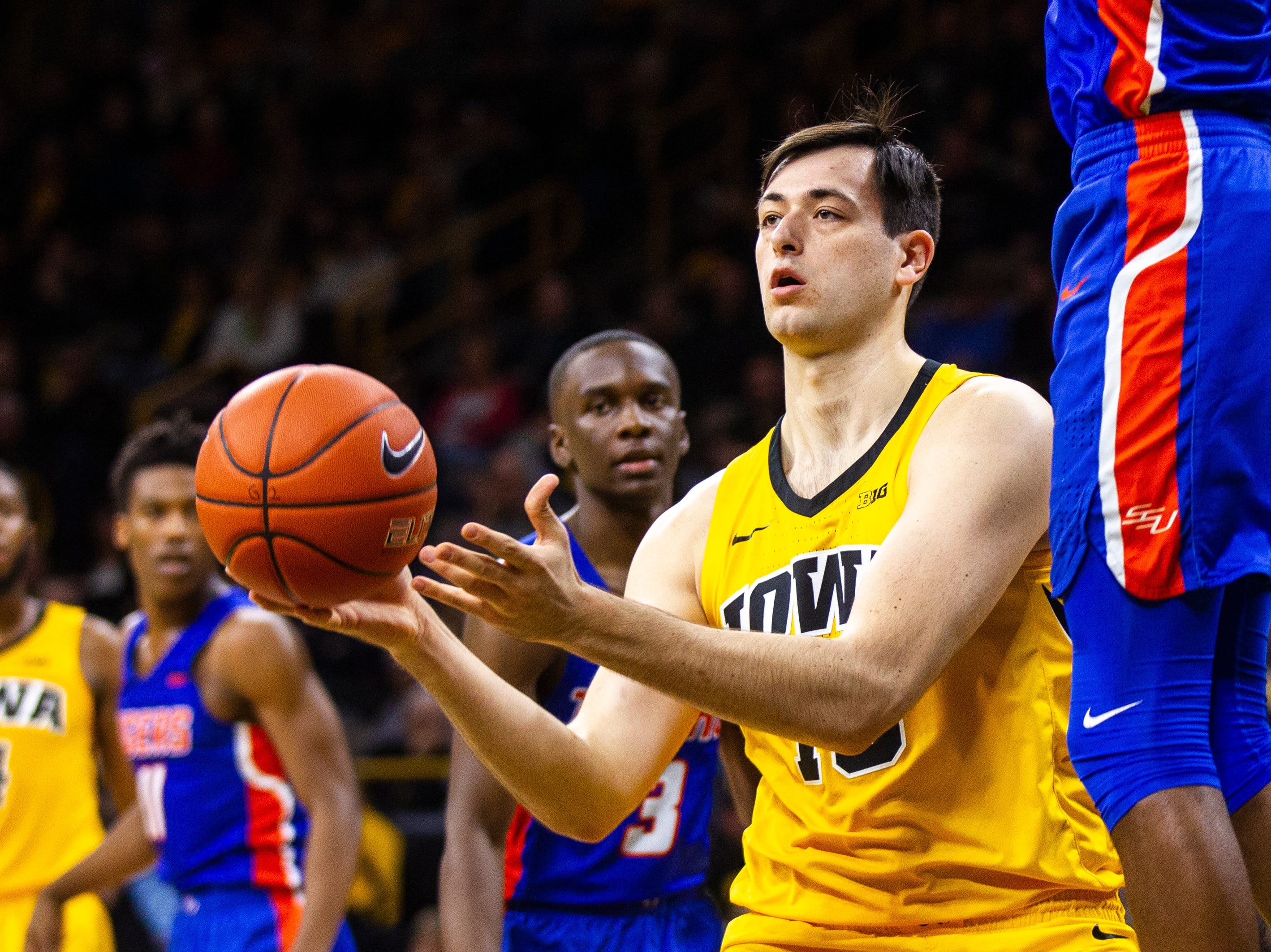 Iowa forward Ryan Kriener (15) passes to a teammate during a NCAA men's basketball game on Saturday, Dec. 22, 2018, at Carver-Hawkeye Arena in Iowa City.