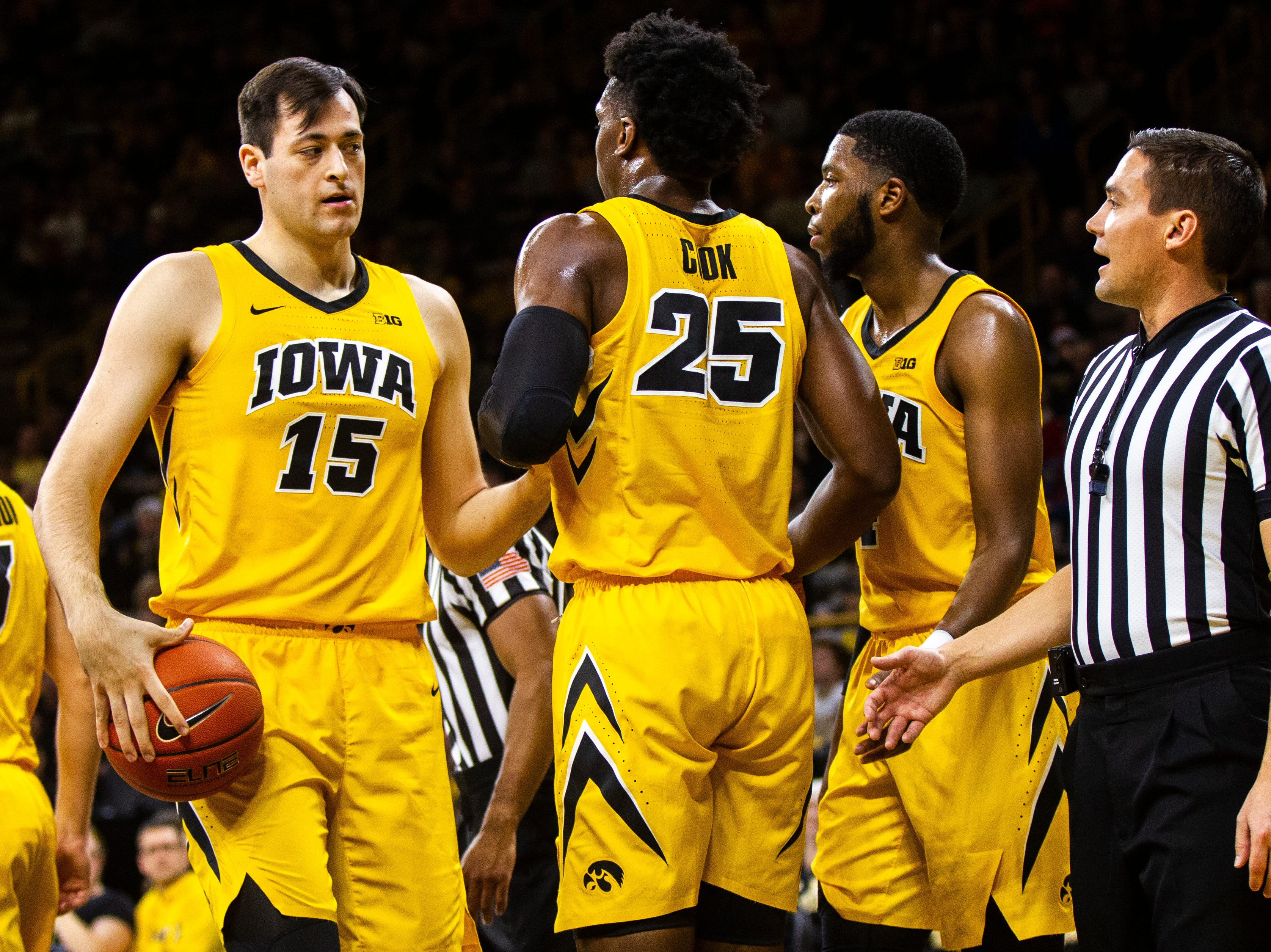 Iowa forward Tyler Cook (25) gets helped up by Iowa forward Ryan Kriener (15) after missing a dunk during a NCAA men's basketball game on Saturday, Dec. 22, 2018, at Carver-Hawkeye Arena in Iowa City.