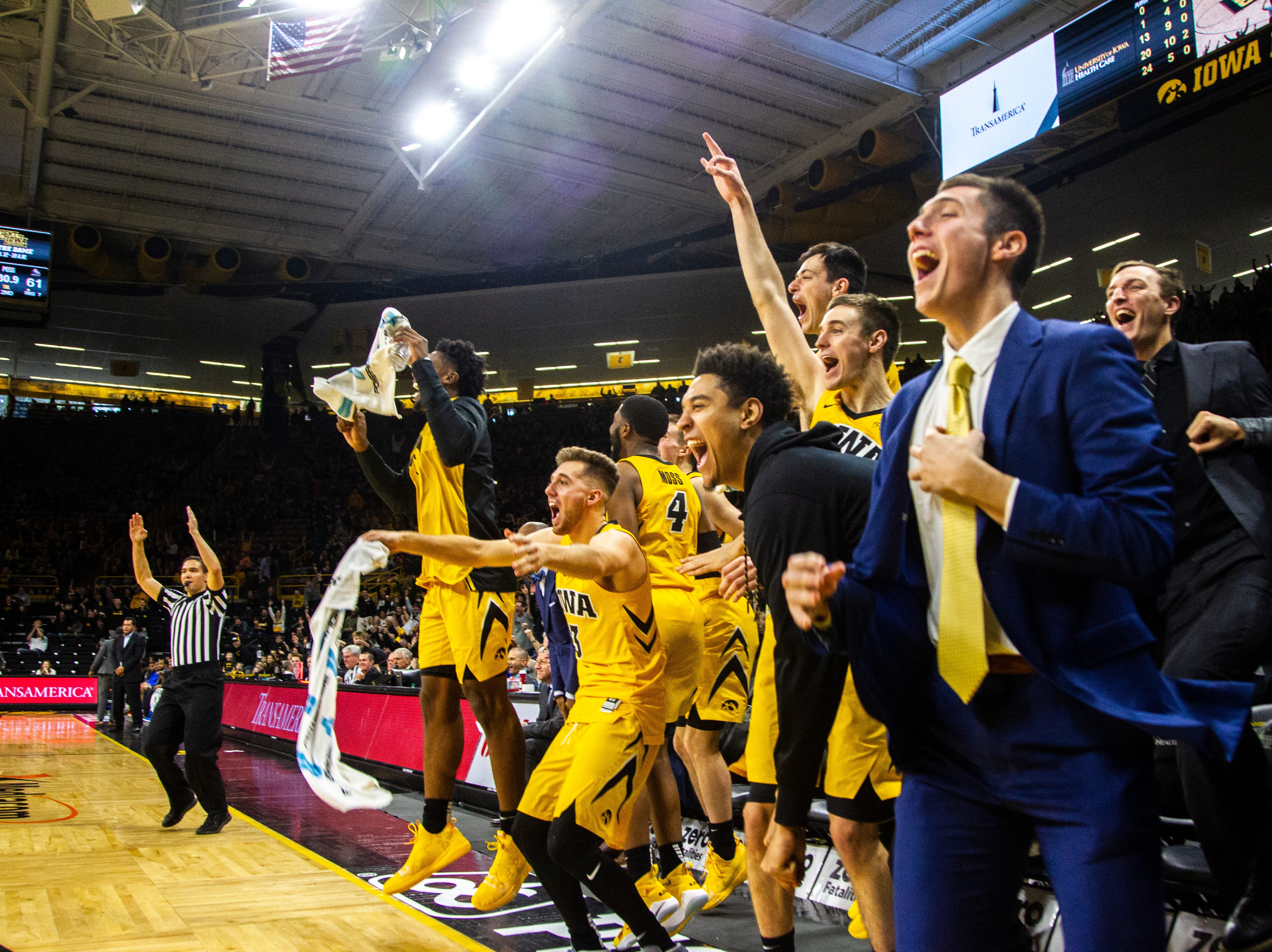 Iowa Hawkeyes players celebrate following a 3-point basket from Michael Baer during a NCAA men's basketball game on Saturday, Dec. 22, 2018, at Carver-Hawkeye Arena in Iowa City. The Hawkeyes defeated Savannah State, 110-64.