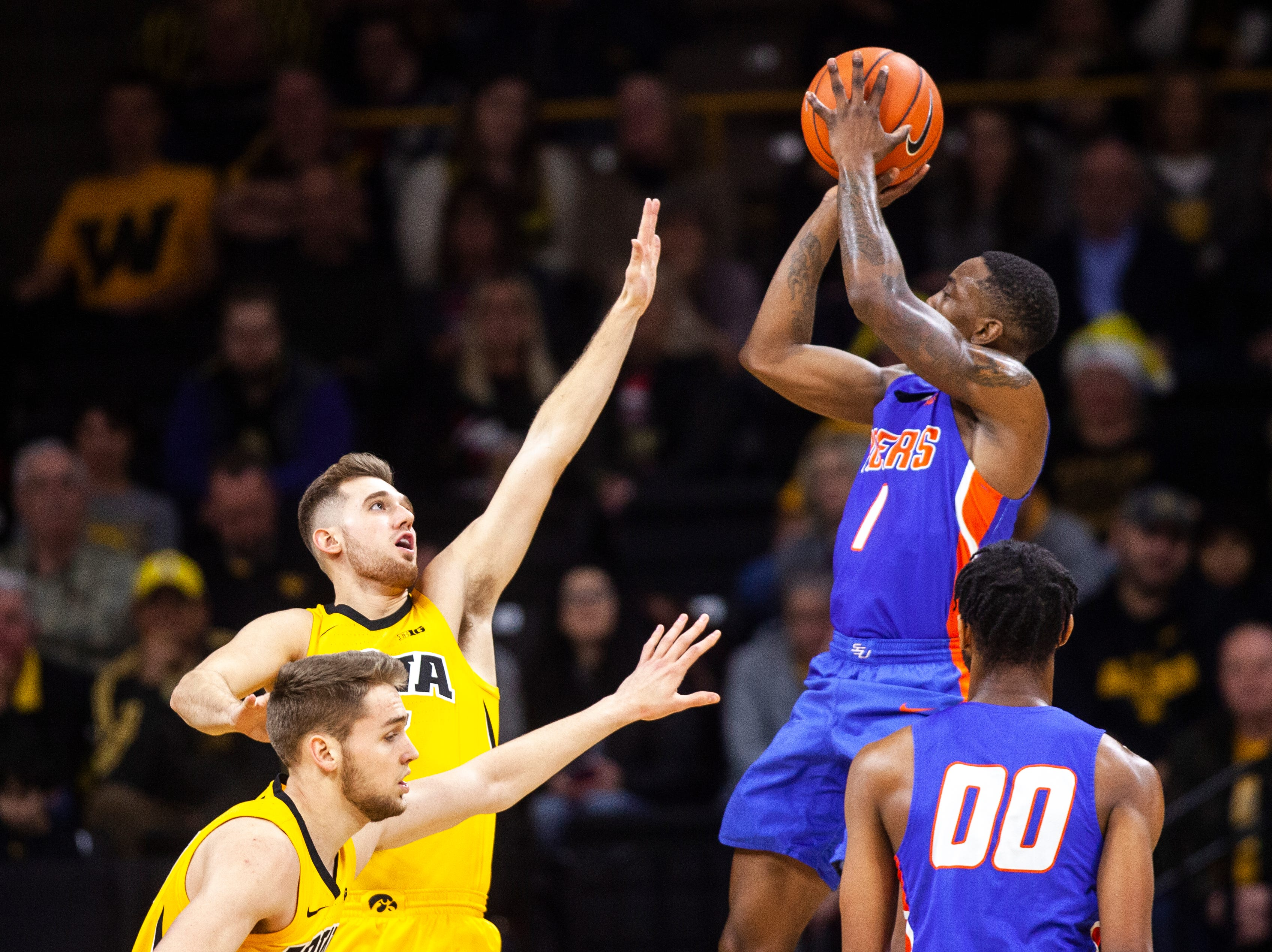 "Savannah State guard Zaquavian ""Qua"" Smith (1) attempts a basket while being defend by Iowa guard Jordan Bohannon (3) during a NCAA men's basketball game on Saturday, Dec. 22, 2018, at Carver-Hawkeye Arena in Iowa City."