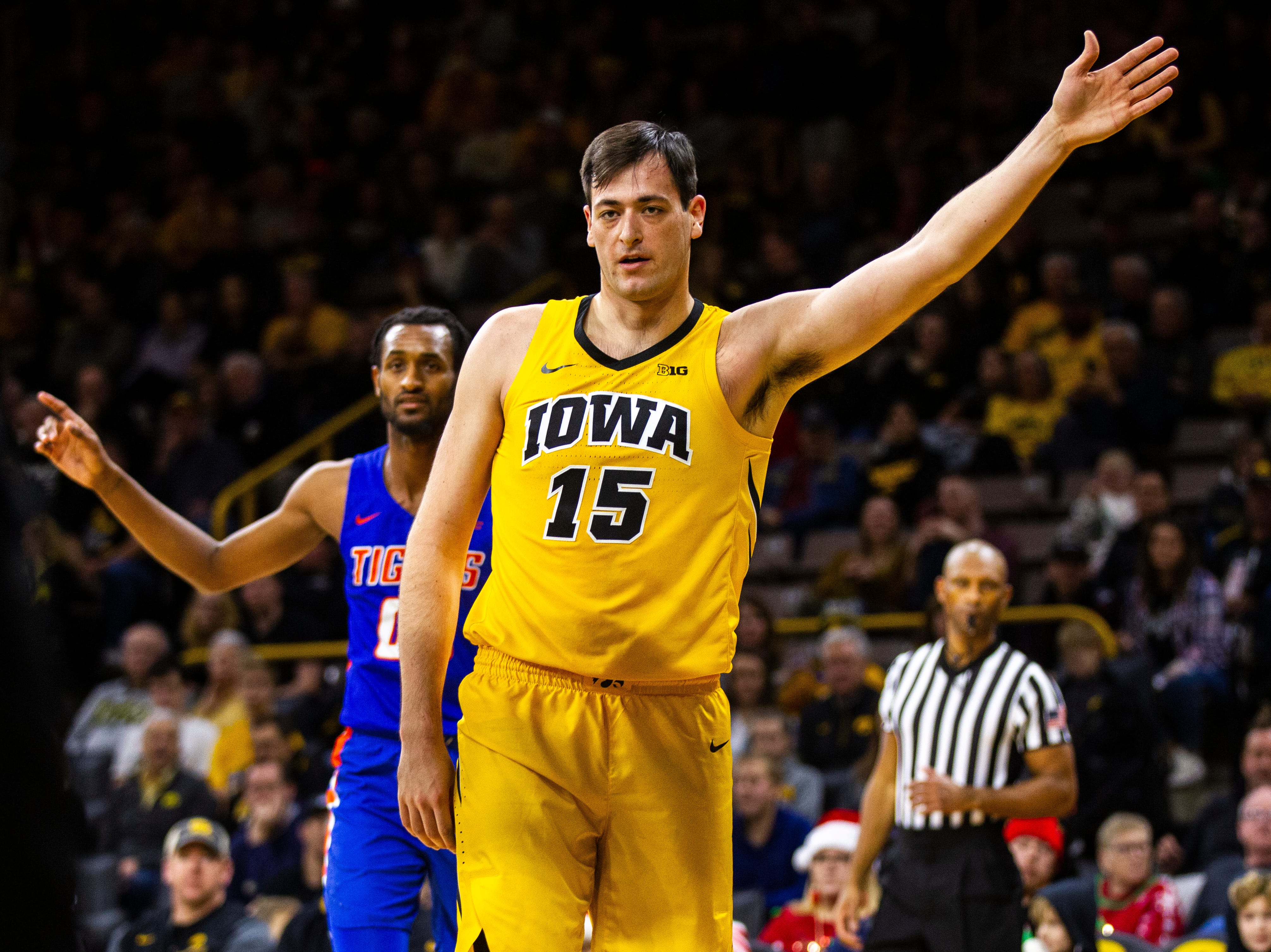 Iowa forward Ryan Kriener (15) gestures for possesion during a NCAA men's basketball game on Saturday, Dec. 22, 2018, at Carver-Hawkeye Arena in Iowa City.